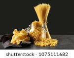 different uncooked pasta on... | Shutterstock . vector #1075111682