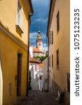 narrow street in cesky krumlov... | Shutterstock . vector #1075123235