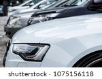 cars parked on parking in row | Shutterstock . vector #1075156118