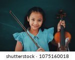 asian cute girl with violin on... | Shutterstock . vector #1075160018