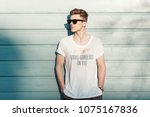 handsome fashion man hipster in ... | Shutterstock . vector #1075167836