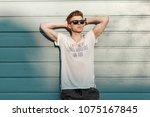 handsome young hipster man with ... | Shutterstock . vector #1075167845