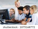teacher helping multiethnic... | Shutterstock . vector #1075168772