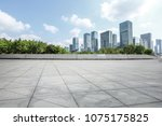 empty square floor and modern... | Shutterstock . vector #1075175825