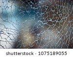 cracks on glass texture broken... | Shutterstock . vector #1075189055