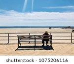 A Senior Woman Sitting On A...