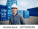 port manager wearing a hardhat... | Shutterstock . vector #1075208186