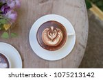 hot latte art in coffee cup on... | Shutterstock . vector #1075213142
