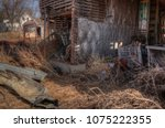 an old neglected farm and... | Shutterstock . vector #1075222355