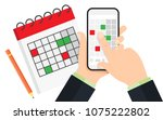 hand holds phone. planning on... | Shutterstock .eps vector #1075222802