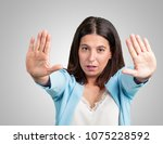 middle aged woman serious and... | Shutterstock . vector #1075228592