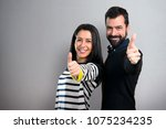 couple with thumb up on grey... | Shutterstock . vector #1075234235