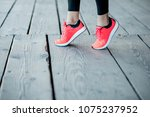 sports woman in running shoes... | Shutterstock . vector #1075237952