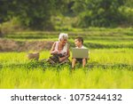 grandmother and children are... | Shutterstock . vector #1075244132