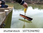 the child launches homemade boat   Shutterstock . vector #1075246982