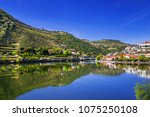 pinhao town with douro river... | Shutterstock . vector #1075250108