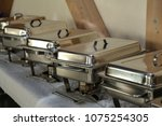 chafing dish in a restaurant | Shutterstock . vector #1075254305
