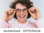 cropped closeup portrait of...   Shutterstock . vector #1075256126