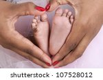 Baby's Feet In Mom's Palms ...