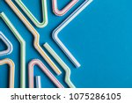 plastic straws on a blue... | Shutterstock . vector #1075286105