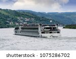 river boat cruising down the... | Shutterstock . vector #1075286702