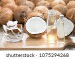 virgin coconut oil in bottle.... | Shutterstock . vector #1075294268
