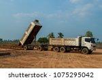 trailer dump truck unloading... | Shutterstock . vector #1075295042