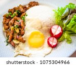 thai style deep fried garlic... | Shutterstock . vector #1075304966