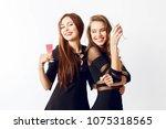 close up studio portrait of two ... | Shutterstock . vector #1075318565