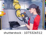 a young female technician while ...   Shutterstock . vector #1075326512