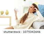happy woman relaxing at home | Shutterstock . vector #1075342646