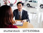 young cheerful asian business... | Shutterstock . vector #1075350866