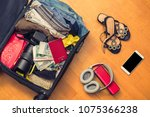 a suitcase with things and a... | Shutterstock . vector #1075366238