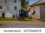 amish buggy parked outside the...   Shutterstock . vector #1075366925