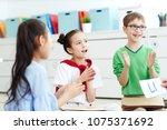 group of elementary school kids ... | Shutterstock . vector #1075371692