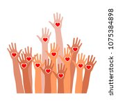 raised hands with heart icon....   Shutterstock .eps vector #1075384898