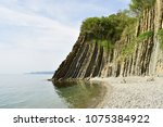 picturesque rock on the beach. | Shutterstock . vector #1075384922