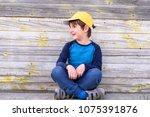 portrait of a cute cheerful boy ... | Shutterstock . vector #1075391876