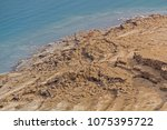 Small photo of Coastline of Dead Sea - salt on coast and in water,View from above.Salt crystals natural mineral formation may be different forms .Dead Sea is the lowest place in the eath. Israel