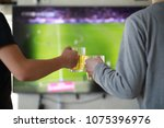 football fans watch the match... | Shutterstock . vector #1075396976
