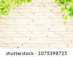 spring green leaves over wood... | Shutterstock . vector #1075398725