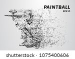 paintball of particles. a man... | Shutterstock .eps vector #1075400606