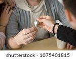 realtor giving couple keys to... | Shutterstock . vector #1075401815