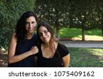 two women sisters smiling with... | Shutterstock . vector #1075409162