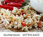 spicy hot popcorn with chili... | Shutterstock . vector #1075411622