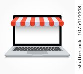 open laptop with striped awning.... | Shutterstock . vector #1075414448