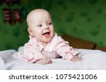 little baby girl playing in the ... | Shutterstock . vector #1075421006