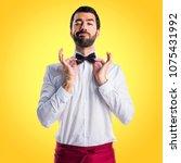 waiter on yellow background | Shutterstock . vector #1075431992