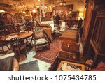 Small photo of ANTWERP, BELGIUM - MAR 30: Buyers inside the antique shop with utensils, lamps, souvenirs and retro furniture on March 30, 2018. More than 1,200,000 people lives in Antwerp