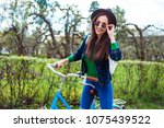 cheerful modern hipster... | Shutterstock . vector #1075439522